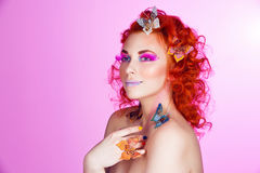 Red hair girl with butterflies Royalty Free Stock Photos