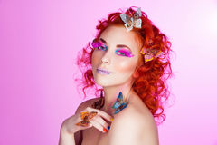 Red hair girl with butterflies Royalty Free Stock Photo