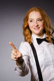 Red hair girl in classic style against gray Stock Photography