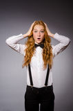 Red hair girl in classic style against gray Royalty Free Stock Photo