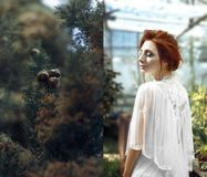 Red hair girl in glasshouse collage stock photos