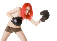 Red-hair girl kick boxer kicked in anger shouting. Over white Stock Photo