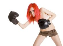 Red-hair girl kick boxer kicked shouting Stock Photography