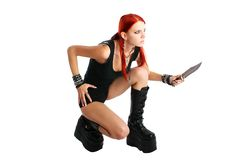Red hair girl with a knife Stock Images