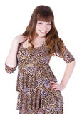 Red-hair girl in leopard dress posing over white Stock Images