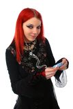 Red hair girl listening MP3 player Stock Photography