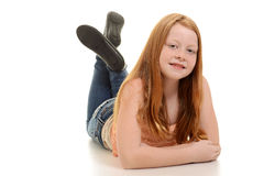 Red hair girl lying down Royalty Free Stock Image