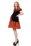 Red hair girl in orange dress isolated on white Stock Photography