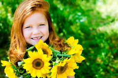 Red hair girl in the park Royalty Free Stock Photo