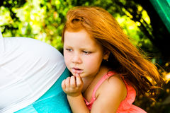Red hair girl in the park Royalty Free Stock Image