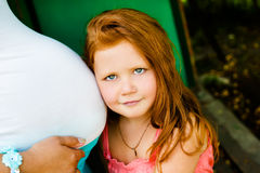 Red hair girl in the park Royalty Free Stock Images
