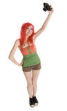 Red-hair girl with photocamera Stock Images