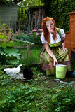 Red hair girl in pin-up style bavarian style outdoor Stock Photo