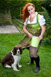 Red hair girl in pin-up style bavarian style outdoor Stock Images