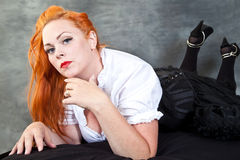 Red hair girl in pin-up style Stock Image