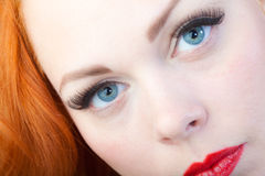 Red hair girl in pin-up style portrait shot in studio Royalty Free Stock Photo