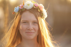 Red hair Girl Portrait in circlet of flowers. Red hair Girl Portrait in circlet of pink white and blue flowers Stock Photos
