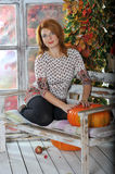 Red hair girl with the pumpkin Stock Photo