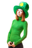Red hair girl in Saint Patrick's Day leprechaun party hat. Having fun isolated on white background Royalty Free Stock Image