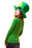 Red hair girl in Saint Patrick's Day leprechaun party hat. Having fun isolated on white background Stock Photos
