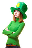 Red hair girl in Saint Patrick's Day leprechaun party hat. Having fun isolated on white background Stock Image