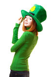 Red hair girl in Saint Patrick's Day leprechaun party hat. Having fun isolated on white background Stock Images