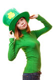 Red hair girl in Saint Patrick's Day leprechaun party hat Stock Images
