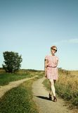 Woman in a path Stock Photography