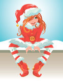 Red hair girl wearing red Santa Claus costume. Stock Photo