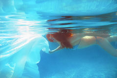 Red-hair girl with white cloth underwater Stock Images