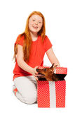 Red hair girls receive dog as present Stock Image