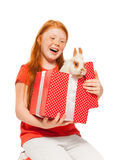 Red hair girls receive rabbit as present Royalty Free Stock Image