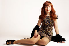 Red hair and leopard print fashion stock photo
