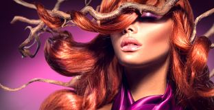 Red hair. Fashion woman with long curly red hair royalty free stock images
