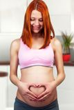Red hair pregnant woman Royalty Free Stock Photos