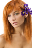 Red hair purple flower Stock Photography