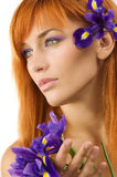 Red hair purple flower Royalty Free Stock Photography