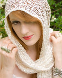 Red Hair, Red Lips. A portrait of a beautiful red haired woman in a netted scarf head covering Royalty Free Stock Photos
