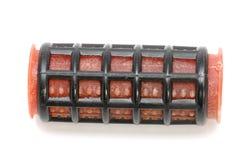 Red hair-rollers macro Stock Image