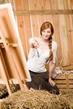 Red-hair romantic woman in barn painting country Royalty Free Stock Image