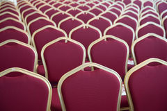 Red hair seats in empty conference room. Close-up shot of chair seats in empty conference room Royalty Free Stock Images