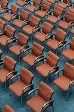 Red hair seats in empty conference room Stock Images