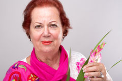 Red Hair Senior with Gladiolus Flower Stock Image