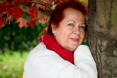 Red Hair Senior Lady Looking at you Happily Royalty Free Stock Photos