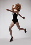 Red hair sporty fashion woman running in studio Royalty Free Stock Photo