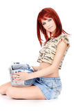 Red hair teenage girl holding CD player Stock Photography