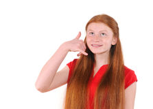 Red hair teenager girl in a red shirt showing a call me sign Stock Photography