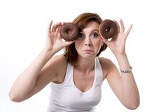 Red hair unhappy woman holding  chocolate donuts Royalty Free Stock Photography