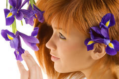 Red hair violet flower stock photos