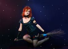 Red hair witch flying on broom Royalty Free Stock Photo